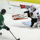 Dallas Stars left wing Ray Whitney (13) misses a penalty shot against Chicago Blackhawks goalie Corey Crawford (50) during the second period of an NHL hockey game Friday, Nov. 29, 2013, in Dallas The Associated Press