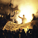 Dinamo fans set fire in the stands during the Group E Europa League match between PSV Eindhoven and Dinamo Moscow at Philips stadium, in Eindhoven, Netherlands, Thursday, Dec. 11, 2014. Dinamo won the match with a 1-0 score, both teams will go on to play