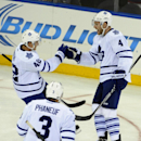 Toronto Maple Leafs' Cody Franson (4) celebrates his goal with Tyler Bozak (42) as Dion Phaneuf (3) skates over join in the first period of an NHL hockey game at Madison Square Garden on Sunday, Oct. 12, 2014, in New York The Associated Press