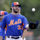 New York Mets pitcher Matt Harvey reaches for a ball during spring training baseball practice Thursday, Feb. 26, 2015, in Port St. Lucie, Fla. (AP Photo/Jeff Roberson)