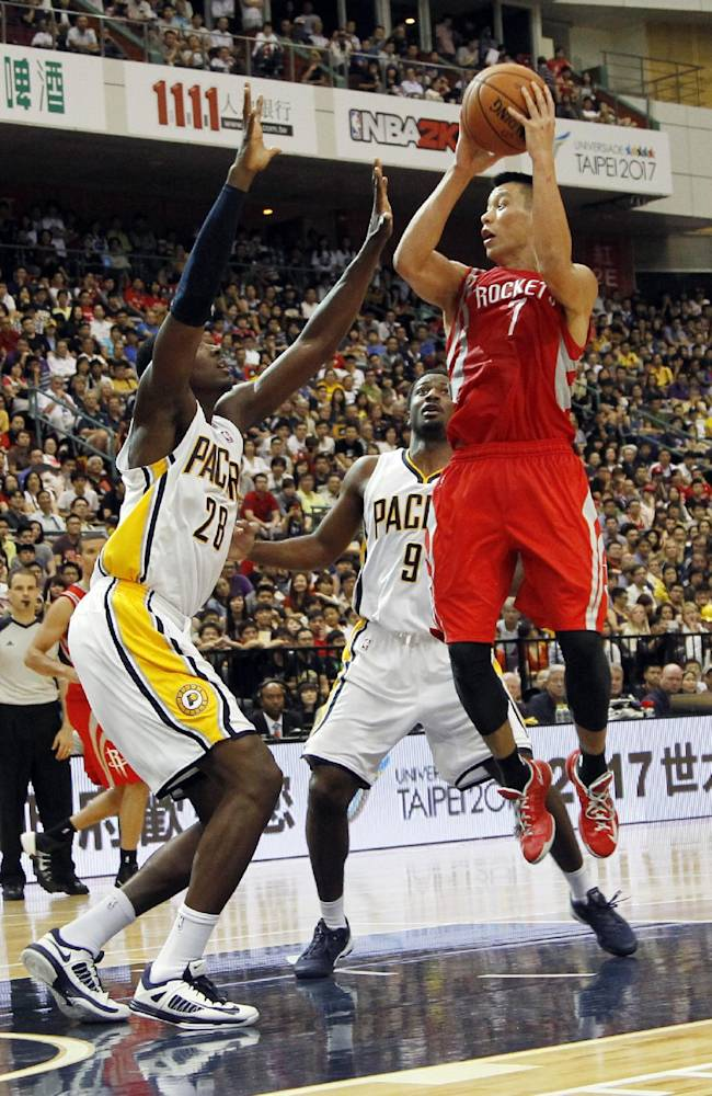 NBA Houston Rockets Jeremy Lin (7) takes a jump shot over Indiana Pacers Ian Mahinmi (28) during a preseason game in Taipei, Taiwan, Sunday, Oct. 13, 2013. The Rockets beat the Pacers 107-98