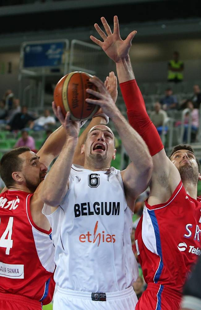 Belgium's Christophe Beghin, center, goes to score as Serbia's Rasco Katic, left, and Djordje Gagic defend during a EuroBasket European Basketball Championship Group E match at the Stozice Arena, in Ljubljana, Slovenia, Wednesday, Sept. 11, 2013