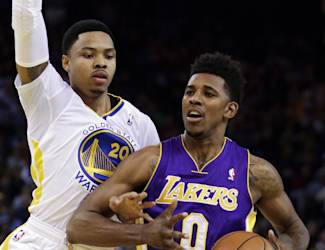 Golden State Warriors' Kent Bazemore, left, guards Los Angeles Lakers' Nick Young (0) during the first half of an NBA basketball game Saturday, Dec. 21, 2013, in Oakland, Calif. (AP Photo/Ben Margot)