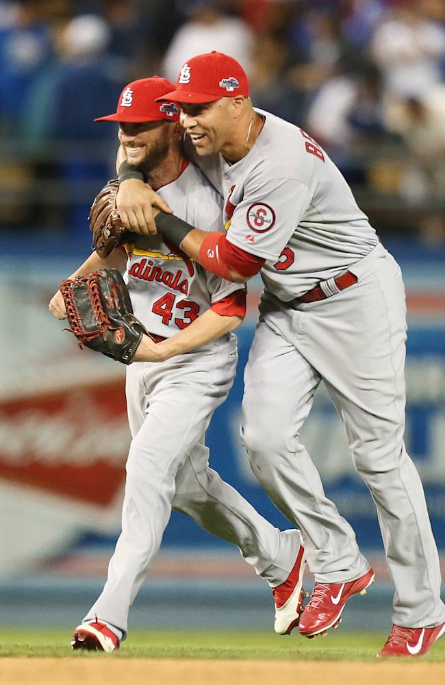 St. Louis Cardinals right fielder Carlos Beltran (right) gets left fielder Shane Robinson in a head lock after the final out during Game 4 of the National League Championship Series between the St. Louis Cardinals and the Los Angeles Dodgers on Tuesday, Oct. 15, 2013, at Dodger Stadium in Los Angeles.  Robinson entered the game as a pinch hitter in the seventh inning and hit a home run. Photo by Chris Lee, clee@post-dispatch.com