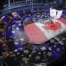 The Canadian flag is projected on the ice at Nationwide Arena as the Canadian national anthem is rehearsed before the NHL All-Star hockey skills competition, Saturday, Jan. 24, 2015 in Columbus, Ohio. (AP Photo/Gene J. Puskar)