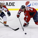 Florida Panthers defenseman Brian Campbell (51) and Washington Capitals left wing Jason Chimera (25) go for the puck in the third period of an NHL hockey game, Saturday, Oct. 18, 2014, in Washington. The Capitals won 2-1 in a shootout The Associated Press
