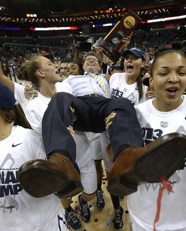 Connecticut players celebrate as they carry their head coach Geno Auriemma after defeating Louisville 93-60 in the national championship game of the women's Final Four of the NCAA college basketball tournament, Tuesday, April 9, 2013, in New Orleans