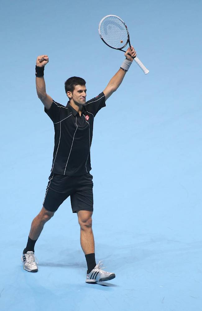 Novak Djokovic of Serbia celebrates after he won the  the final ATP World Tour Finals tennis match against Rafael Nadal of Spain at the O2 Arena in London, Monday, Nov. 11, 2013