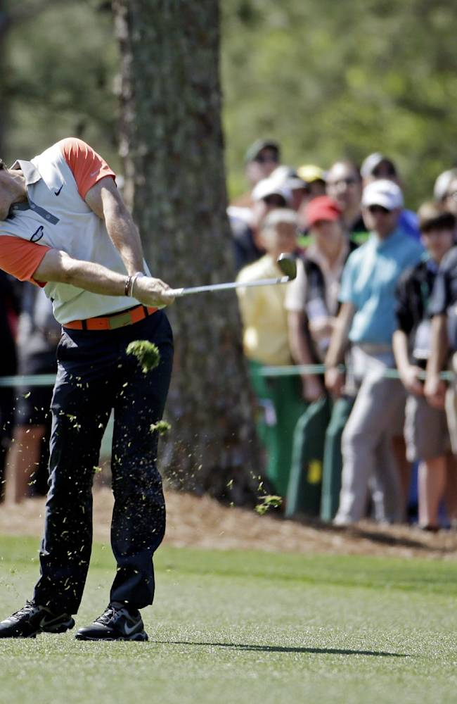 Rory McIlroy, of Northern Ireland, hits on the first fairway during the first round of the Masters golf tournament Thursday, April 10, 2014, in Augusta, Ga