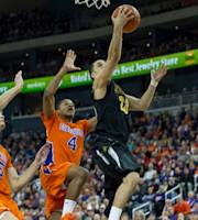 Wichita State's Fred Vanvleet, (23), goes up for a shot as University of Evansville's Egidijus Mockevicius, (55), and Duane Gibson, (4), tries to block the shot in the first half of an NCAA college basketball game at the Ford Center in Evansville, Ind., Sunday Feb. 16, 2014. (AP Photo/Daniel R. Patmore)