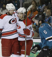 Carolina Hurricanes' Elias Lindholm (16), of Swedend celebrates goal next to San Jose Sharks' Jason Demers (5) and teammate Eric Staal during the second period of an NHL hockey game on Tuesday, March 4, 2014, in San Jose, Calif. (AP Photo/Marcio Jose Sanchez)