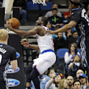 New York Knicks' Raymond Felton lays up under the basket as Minnesota Timberwolves' Corey Brewer, right, looms over him in the first quarter of an NBA basketball game, Wednesday, March 5, 2014, in Minneapolis The Associated Press