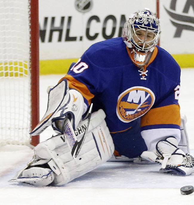 New York Islanders goalie Evgeni Nabokov (20) stops a shot on the goal during the first period of an NHL hockey game against the New York Rangers Tuesday, Oct. 29, 2013, in Uniondale, N.Y