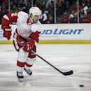 Detroit Red Wings' Brendan Smith handles carries the puck during the first period against the Chicago Blackhawks in an NHL exhibition hockey game in Chicago, Tuesday, Sept. 23, 2014. The Associated Press