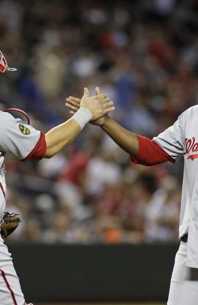 Washington Nationals pitcher Rafael Soriano (29) is congratulated by catcher Wilson Ramos after throwing in the ninth inning in a 2-0 victory over the Arizona Diamondbacks during a baseball game on Saturday, Sept. 28, 2013, in Phoenix