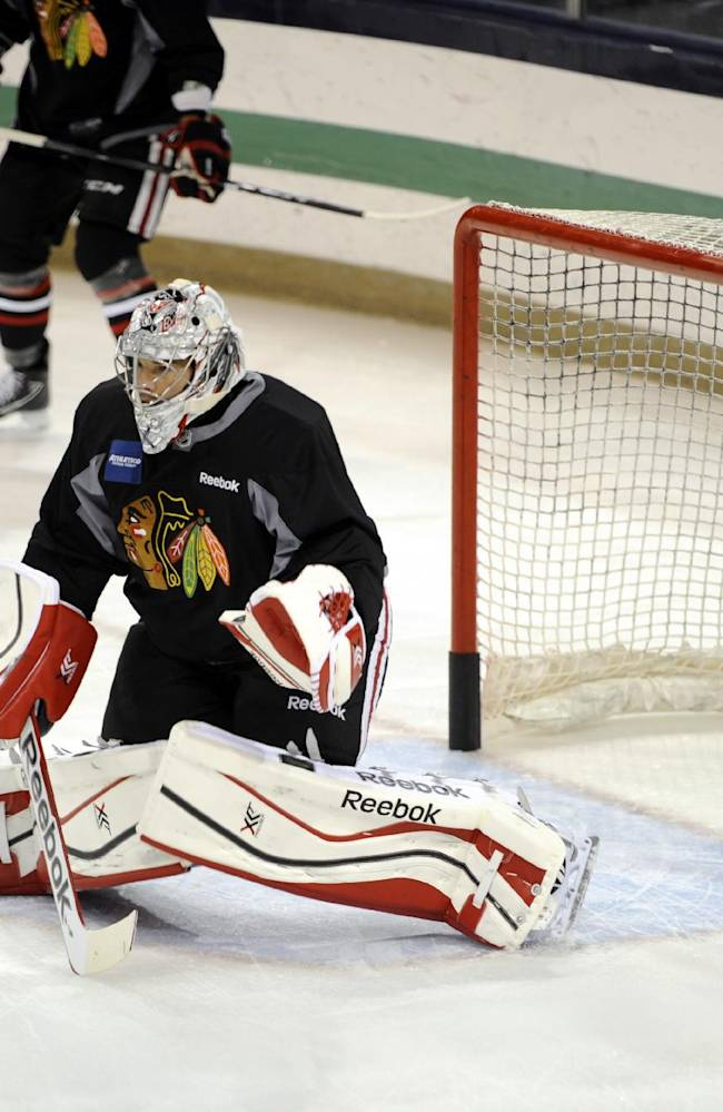 Chicago Blackhawks goaltender Corey Crawford makes a save during practice at the teams NHL hockey training camp on the campus of the University of Notre Dame in South Bend, Ind., Thursday, Sept. 12, 2013
