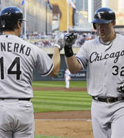 Chicago White Sox's Paul Konerko, left, congratulates Adam Dunn after Dunn's solo home run off Minnesota Twins pitcher Kevin Correia in the third inning of a baseball game, Friday, Aug. 16, 2013, in Minneapolis. (AP Photo/Jim Mone)