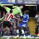 Sunderland's goalkeeper Vito Mannone, left, jumps for the ball in front of Chelsea's Demba Ba during their English Premier League soccer match at the Stamford Bridge ground in London, Saturday, April 19, 2014. Sunderland won the match 2-1