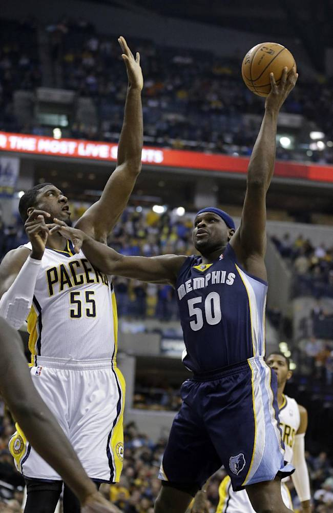 Memphis Grizzlies forward Zach Randolph, right, shoots over Indiana Pacers center Roy Hibbert in the first half of an NBA basketball game in Indianapolis, Monday, Nov. 11, 2013