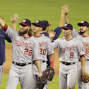 Washington Nationals' Jayson Werth (28), Ian Desmond (20), Danny Espinosa (8) and Anthony Rendon (6) high-five their teammates after the Nationals defeated the Miami Marlins 9-2 in MLB National League baseball game, Monday, April 14, 2014, in Miami The As