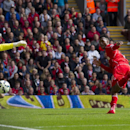 Liverpool's Daniel Sturridge, right, scores past Southampton's Fraser Forster during their English Premier League soccer match at Anfield Stadium, Liverpool, England, Sunday Aug. 17, 2014