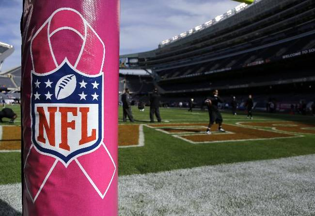 A goal post is covered with the pink NFL cover for Breast Cancer Awareness month before an NFL football game between the Chicago Bears and the New Orleans Saints, Sunday, Oct. 6, 2013, in Chicago