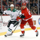 Dallas Stars left wing Travis Moen (27) and Detroit Red Wings left wing Johan Franzen (93) battle for the puck in the first period during an NHL hockey game in Detroit Thursday, Dec. 4, 2014 The Associated Press