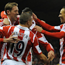 Stoke's Peter Crouch, left, celebrates with team mates after scoring against Swansea during the English Premier League soccer match between Stoke City and Swansea City at Britannia Stadium in Stoke On Trent, England, Wednesday, Feb. 12, 2014
