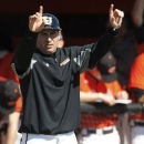 In this Feb. 21, 2013, photo provided by Campbell University, Campbell coach Greg Goff signals his players during an NCAA college baseball game against Hartford in Buies Creek, N.C. Campbell is ranked in the major polls this week and is trying to make the NCAA tournament for the second time, and first time since 1990. The Fighting Camels go into this weekend's series against Longwood, starting Friday, April 12, with a 29-6 record and leading the North Division of the Big South Conference. (AP Photo/Campbell University, Bennett Scarborough)