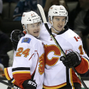 Calgary Flames' Jiri Hudler, left, is congratulated by Mikael Backlund after Hudler scored against the San Jose Sharks during the second period of an NHL hockey game Saturday, Jan. 17, 2015, in San Jose, Calif The Associated Press
