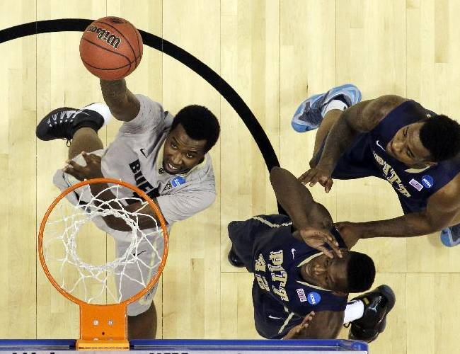 Colorado forward Wesley Gordon (1) goes for the basket as Pittsburgh forwards Talib Zanna (42) and Michael Young (2) defend during a second-round game in the NCAA college basketball tournament Thursday, March 20, 2014, in Orlando, Fla