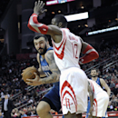 Minnesota Timberwolves' Nikola Pekovic (14) pushes against Houston Rockets' Dwight Howard (12) on his way to the basket in the first half of an NBA basketball game Saturday, Nov. 23, 2013, in Houston The Associated Press