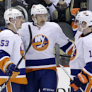 New York Islanders' Colin McDonald (13) celebrates his second-period goal with teammates Casey Cizikas (53) and Thomas Hickey (14) during an NHL hockey game against the Pittsburgh Penguins in Pittsburgh, Friday, Nov. 22, 2013 The Associated Press