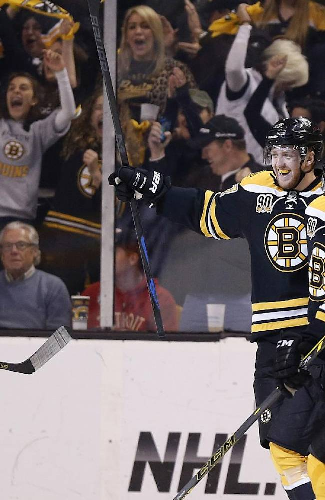 Boston Bruins' Loui Eriksson, second from right, celebrates his goal with teammates during the first period  in Game 5 in the first round of the NHL hockey Stanley Cup playoffs against the Detroit Red Wings in Boston, Saturday, April 26, 2014