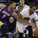 Los Angeles Lakers' Xavier Henry, left, fights for the ball with Golden State Warriors' Andre Iguodala (9) during the first half of an NBA basketball game Saturday, Dec. 21, 2013, in Oakland, Calif. (AP Photo/Ben Margot)