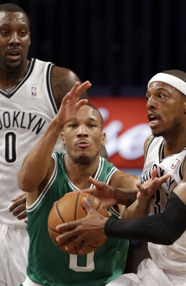 Boston Celtics' Avery Bradley (0) defends against Brooklyn Nets' Paul Pierce (34) as Nets' Andray Blatche (0) looks on during the first half of a preseason NBA basketball game Tuesday, Oct. 15, 2013, in New York
