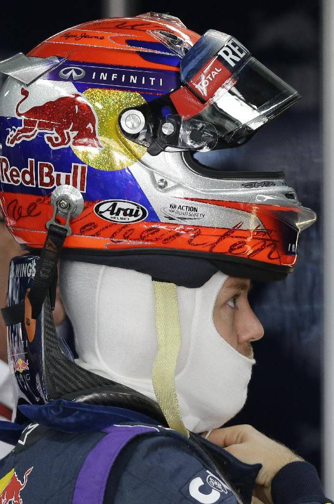 Red Bull driver Sebastian Vettel of Germany prepares for the first practice session for the Korean Formula One Grand Prix at the Korean International Circuit in Yeongam, South Korea, Friday, Oct. 4, 2013