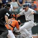 New York Yankees' Jacoby Ellsbury, right, tries to avoid Baltimore Orioles catcher Nick Hundley (40) during the seventh inning of a baseball game, Saturday, July 12, 2014, in Baltimore. Ellsbury was out at home on the play. The Yankees won 3-0. (AP Photo/Nick Wass)