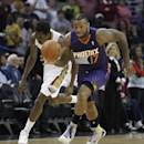 Phoenix Suns forward P.J. Tucker (17) steals the ball from New Orleans Pelicans forward Al-Farouq Aminu in the first half of an NBA basketball game in New Orleans, Wednesday, April 9, 2014 The Associated Press