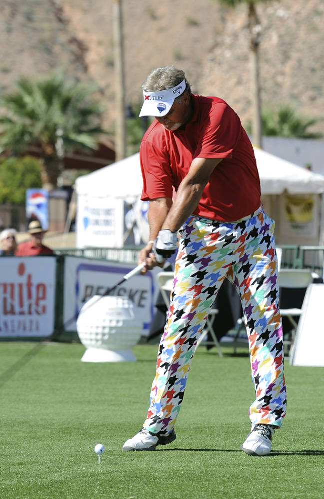 In this photo provided by the Las Vegas News Bureau, Bobby Wilson competes in the Grand Champions Division of the RE/MAX Long Drive Championship held in Mesquite, Nev., Saturday, Sept. 21, 2013. Wilson won the division,