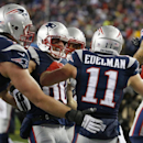 New England Patriots wide receiver Danny Amendola, center, celebrates his 51-yard touchdown pass from Julian Edelman (11) in the second half of an NFL divisional playoff football game against the Baltimore Ravens Saturday, Jan. 10, 2015, in Foxborough, Ma
