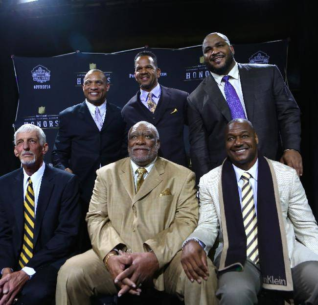 Clockwise from top left, defensive back Aeneas Williams, wide receiver Andre Reed, offensive tackle Walter Jones, linebacker Derrick Brooks , defensive lineman Claude Humphrey and punter Ray Guy pose for a photo at the NFL Honors show Saturday, Feb. 1, 2014 at Radio City Music Hall in New York