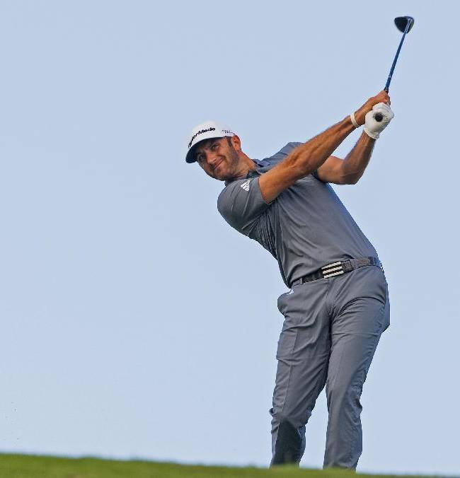 Dustin Johnson shoots off the ninth fairway during the second round of the Tournament of Champions golf tournament, Saturday, Jan. 4, 2014, in Kapalua, Hawaii