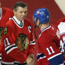 FILE - In this Jan. 8, 2008, file photo, Montreal Canadiens captain Saku Koivu (11) talks with Chicago Blackhawks great Stan Mikita during a pregame ceremony in Montreal. Mikita's family says the Blackhawks Hall of Famer has been diagnosed with a suspected brain disorder, adding that the 74-year-old is