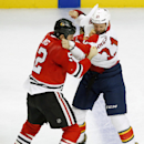 Chicago Blackhawks left wing Brandon Bollig, left, and Florida Panthers right wing Krys Barch fight during the third period of an NHL hockey game on Sunday, Dec. 8, 2013, in Chicago, Ill The Associated Press