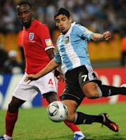 England's Saido Berahino, left, battles for the ball with Argentina's Matias Laba during a U-20 World Cup group F soccer match in Medellin, Colombia, Monday, Aug. 1, 2011. (AP Photo/Luis Benavides)
