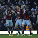 West Ham's Stewart Downing, center, celebrates with teammates Enner Valencia, left, and Carl Jenkinson after scoring his side's third goal during the English Premier League soccer match between West Ham and Hull City at Upton Park stadium in London, Sunda