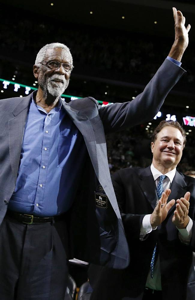 Boston Celtics great Bill Russell waves to the crowd during a tribute in his honor in the second quarter of an NBA basketball game between the Celtics and the Milwaukee Bucks in Boston, Friday, Nov. 1, 2013
