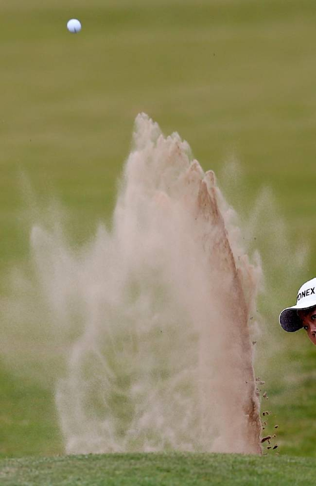 South Korea's Sun Ju Ahn plays a shot from the bunker onto the 18th green during the third day of the Women's British Open golf championship on the Royal Birkdale Golf Club, Southport, England, Saturday July 12, 2014