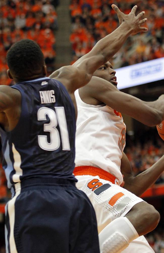 Syracuse's Jerami Grant, right, drives to the basketball against Villanova's Dylan Ennis, left, during the first half of an NCAA college basketball game in Syracuse, N.Y., Saturday, Dec. 28, 2013